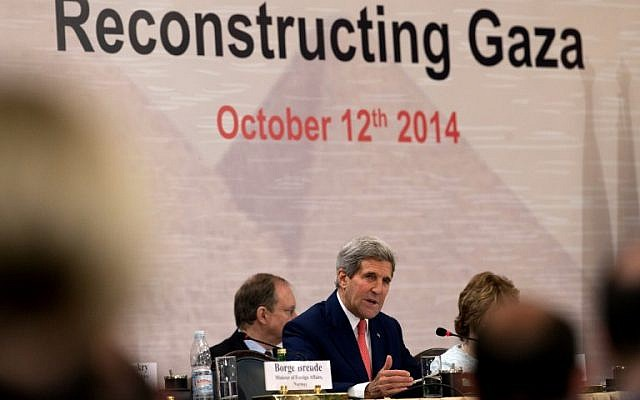 US Secretary of State John Kerry speaks during the opening session of the Gaza donor conference in Cairo on October 12, 2014, aimed at helping rebuild the Gaza Strip. (photo credit: AFP/Carolyn Kaster/Pool)