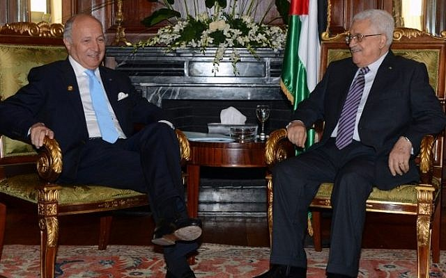 Palestinian Authority President Mahmud Abbas (R) meeting with French Foreign Minister Laurent Fabius during the Gaza Donor Conference in Cairo on October 12, 2014. photo credit: (AFP/PPO / THAER GHANEM)