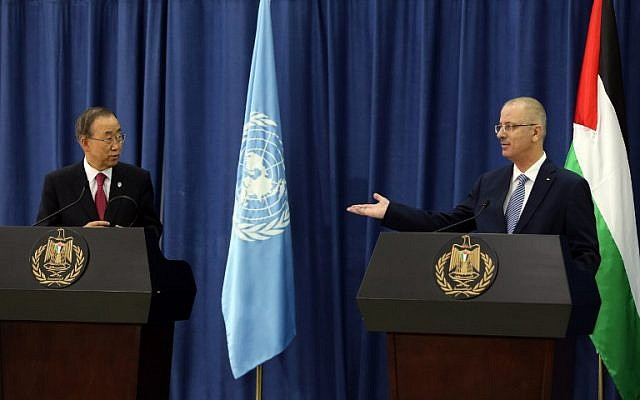 Palestinian prime minister Rami Hamdallah, right, gestures towards UN Secretary-General Ban Ki-Moon during a press conference following his arrival in the West Bank city of Ramallah on October 13, 2014. (photo credit: AFP/ABBAS MOMANI)