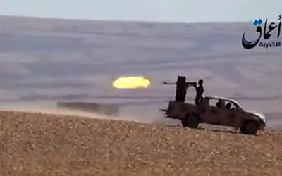Illustrative screen capture from a YouTube video allegedly shows Islamic State group fighters firing from an armed vehicle (AFP/HO/AAMAQ NEWS AGENCY)