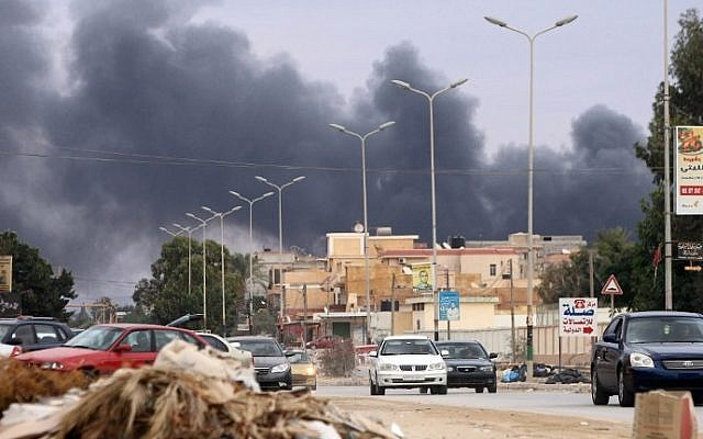 Illustrative: Fighting between between pro-government forces led by Haftar and Islamist militias Libya's second city  on October 22 2014. (Photo Credit AFP / ABDULLAH DOMA)