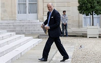 French Foreign Minister Laurent Fabius, arrives at the Elysee palace to attend a meeting on October 13, 2014, in Paris. (photo credit: AFP/THOMAS SAMSON)
