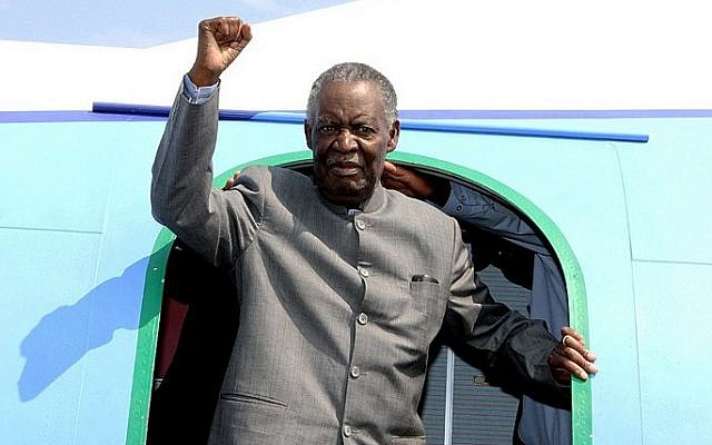 Zambian President Michael Sata gesturing upon his arrival at the Solwezi airport before an election campaign meeting, September 10, 2014. (photo credit: AFP/STRINGER)