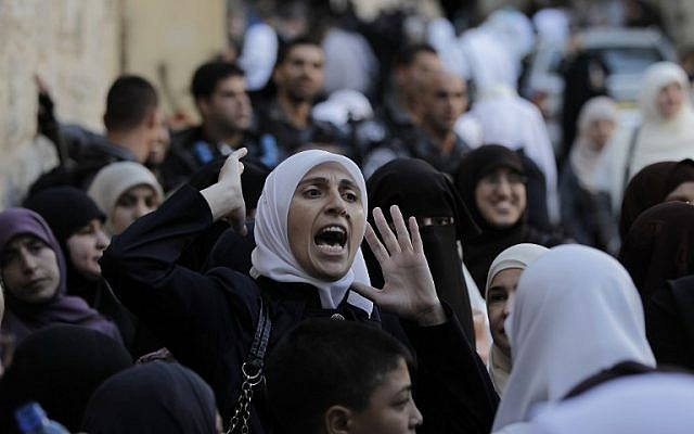 A Palestinian woman shouts after being blocked by Israel security forces from entering the Al-Aqsa Mosque compound, Islam's third most holy site in Jerusalem on October 13, 2014. (photo credit: AFP/Ahmad Gharabli)