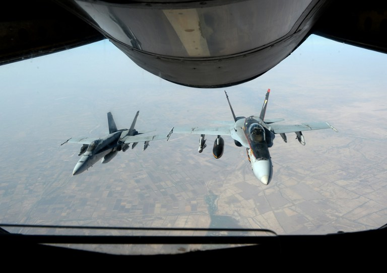 Illustrative photo of two US Super Hornets supporting operations against IS, October 4, 2014. (AFP/US Air Force handout/Staff Sgt. Shawn Nickel)