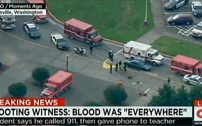 Police and ambulances at Marysville-Pilchuck High School in Marysville, Washington after a student opened fire inside the school before killing himself on October 24, 2014. (photo credit: AFP/HANDOUT-CNN/KOMO)