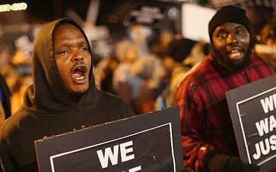 Demonstrators protest outside the Ferguson police department on October 10, 2014 in Ferguson, Missouri. (Scott Olson/Getty Images/AFP)