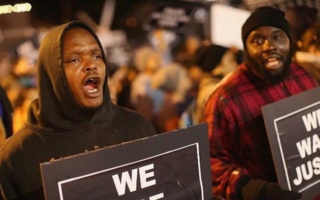 Demonstrators protest outside the Ferguson police department on October 10, 2014 in Ferguson, Missouri. (Scott Olson/Getty Images/AFP)