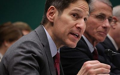 Director of the Centers for Disease Control and Prevention Dr. Thomas Frieden (left), testifies during a hearing on Ebola, on Capitol Hill in Washington, DC, October 16, 2014. (photo credit: Alex Wong/Getty Images/AFP)