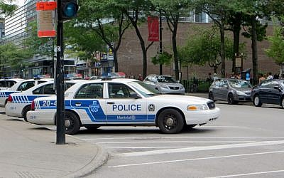 An illustrative photo of Montreal police (photo credit: Flickr/CC BY-SA/Jorge from Brazil)