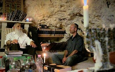 Rav Avraham Sutton and 'Kabbalah Me' director Steven Bram learning Jewish mysticism in a cave. (courtesy)