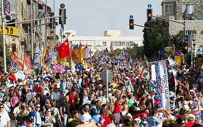 Feast of Tabernacle pilgrims march through the streets of Jerusalem. October 14, 2014. (Courtesy ICEJ)