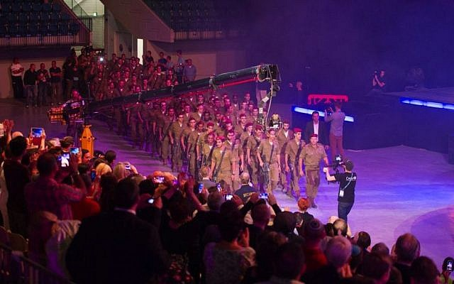"Audience members give standing ovation to IDF paratroopers as they march in to ""Israeli Night"" at the Feast of Tabernacles. October 14, 2014. (Courtesy ICEJ)"