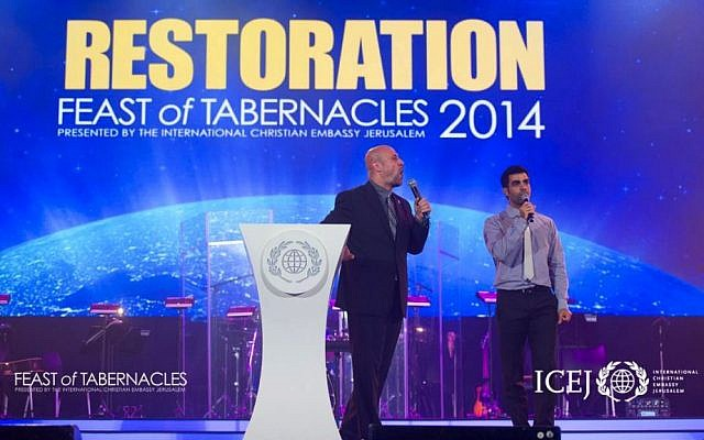 "Dr. Robert Stearns of Eagels' Wings (left) gives the keynote sermon at Feast of Tabernacles ""Israeli Night"" on October 14, 2014. (Courtesy ICEJ)"
