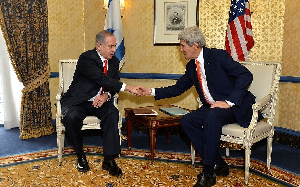 Benjamin Netanyahu, left, shaking hands with John Kerry in Washington in March 2014. (photo credit: US State Department)