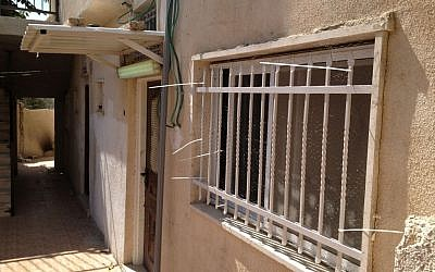 Wire netting covers one of the homes sold to Jews in Silwan, East Jerusalem, October 2, 2014 (photo credit: Elhanan Miller/Times of Israel)
