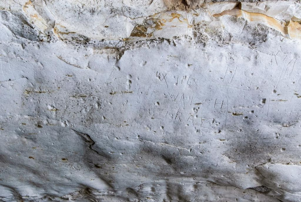The engraved graffiti left by the Australian soldiers during WWII at the site of an ancient Jewish ritual bath (mikveh) discovered by Israel Antiquities Authorites near the Ha'elah junction in Israel. (photo credit: Assaf Peretz/courtesy: Israel Antiquities Authority)