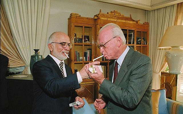 King Hussein of Jordan lights Yitzhak Rabin's cigarette following the signing ceremony for the peace accord between Amman and Jerusalem, October 26, 1994. (GPO/Moshe Milner)