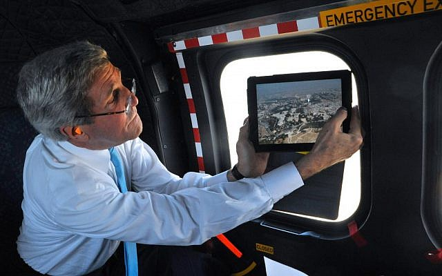 US Secretary of State John Kerry photographs the Dome of the Rock after a helicopter carrying him to Amman, Jordan, took off from Jerusalem on June 29, 2013. (photo credit: US State Department)