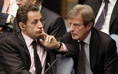 Nicolas Sarkozy, left, then-president of France, talks with his Foreign Minister Bernard Kouchner in the United Nations Security Council, Thursday, Sept. 24, 2009. (photo credit: AP Photo/Richard Drew)