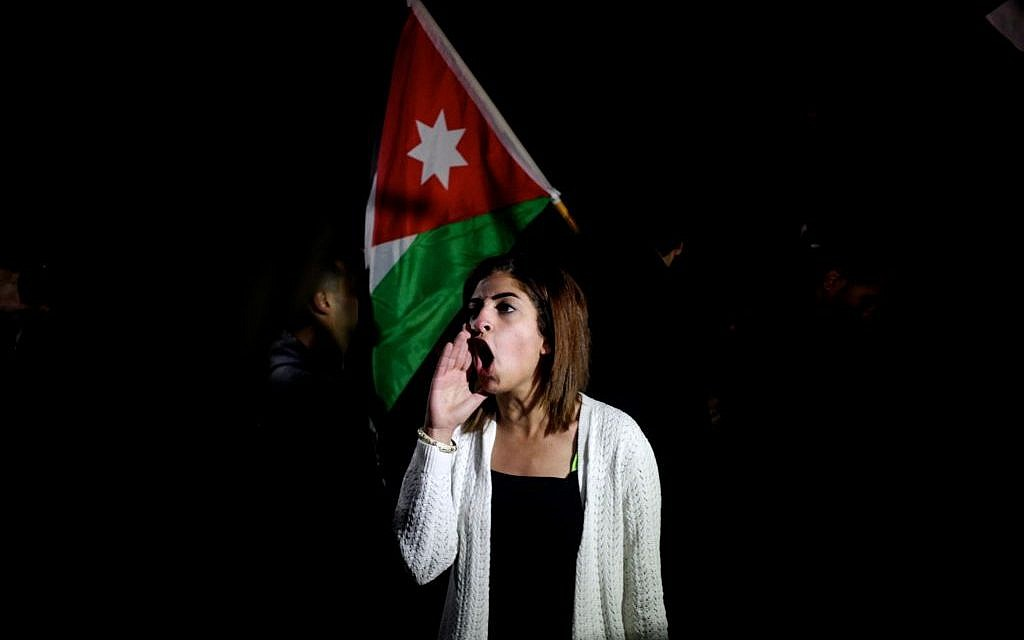 A Jordanian protester shouts slogans across the street from the Israeli embassy demanding the deportation of the Israeli ambassador after the killing of Jordanian judge Raed Zueter, 38, at Allenby crossing between Jordan and the West Bank, in Amman, Jordan, Monday, March 10, 2014 (photo credit: AP/Mohammad Hannon)