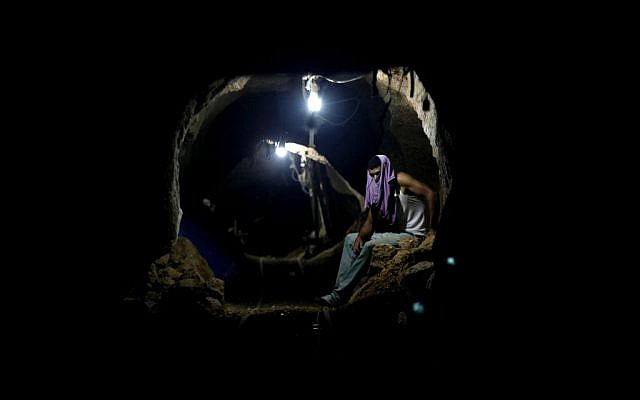 In this Monday, September 30, 2013 file photo, a Palestinian worker rests inside a smuggling tunnel in Rafah, on the border between Egypt and the southern Gaza Strip. (AP/Hatem Moussa)