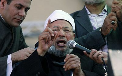 Sheikh Youssef Qaradawi speaks to a crowd in Cairo's Tahrir Square, February 2, 2014 (Khalil Hamra/AP)