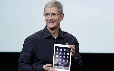 Apple CEO Tim Cook introduces the Apple iPad Air 2 at Apple headquarters in Cupertino, California, October 16, 2014. (photo credit: AP/Marcio Jose Sanchez)
