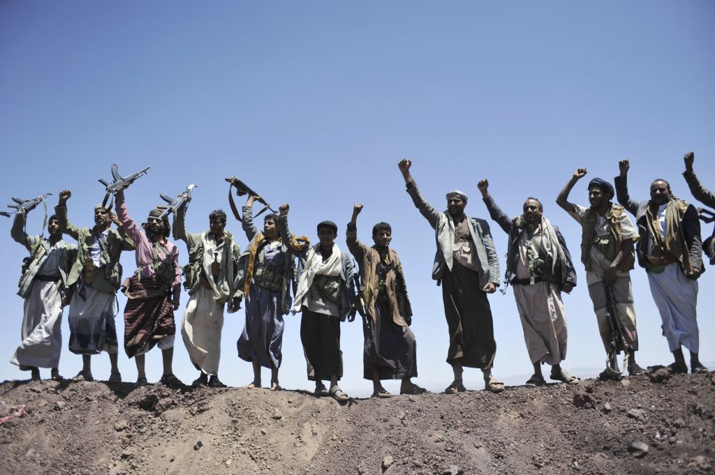 Hawthi Shiite rebels chant slogans at the compound of the army's First Armored Division, after they took it over, in Sanaa, Yemen, Sept. 22, 2014. (photo credit: AP Photo/Hani Mohammed)
