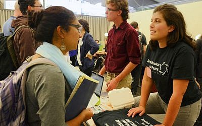 A representative of Jewish Voice for Peace speaking with a student at the Open Hillel conference at Harvard University, October 12, 2014. (Gili Getz/JTA)