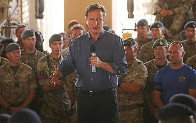 Britain's Prime Minister David Cameron addresses British troops, in Camp Bastion, Afghanistan, Friday, Oct. 3, 2014. (photo credit: AP Photo/Dan Kitwood, Pool)