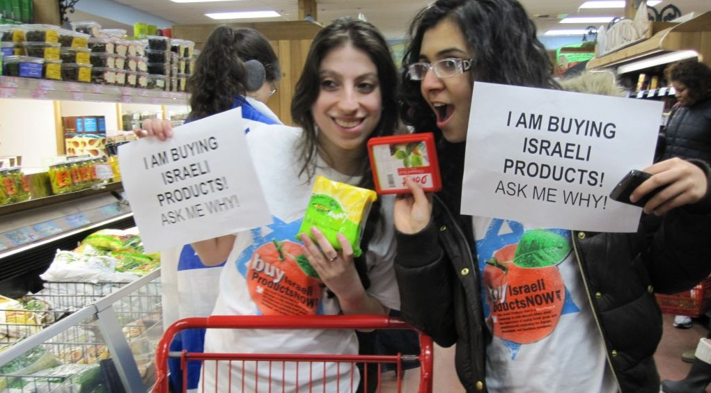 Two David Project-educated New York University students participate in an Israeli products BuyCott to combat Israel Apartheid Week, March 2010. (Courtesy: The David Project/JTA)