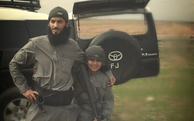 """A reported Islamic State fighter and his son, the group's """"youngest martyr,"""" both said killed in a US airstrike. (photo credit: @ISTimes1, Twitter)"""