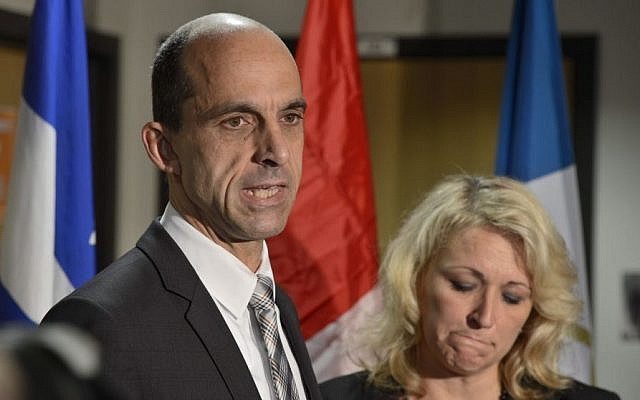 Canadian Public Safety Minister Steven Blaney and Quebec Public Security Minister Lise Theriault address reporters at a news conference in St-Jean-sur-Richelieu, Quebec, on Tuesday Oct. 21, 2014. (AP/The Canadian Press, Paul Chiasson)