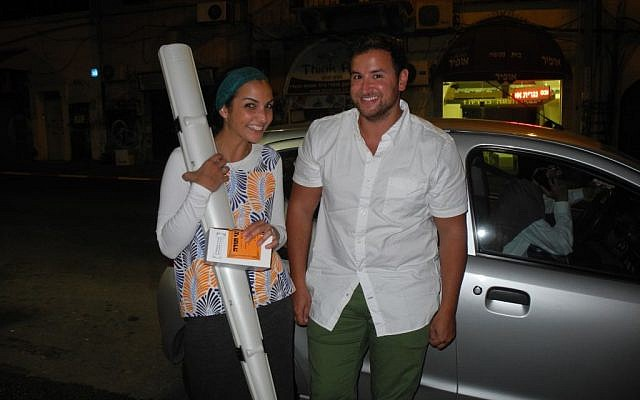 Tanya and Josh Saunders make a late night lulav and etrog delivery about an hour before my flight. Usually you can't even get a pizza this quickly! (Melanie Lidman/Times of Israel)