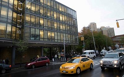 Cars pass Manhattan's Bellevue Hospital where Craig Spencer, a Doctors Without Borders physician who recently returned to the city after treating Ebola patients in West Africa, was rushed to Thursday, Oct. 23, 2014, in New York. (AP Photo/John Minchillo)