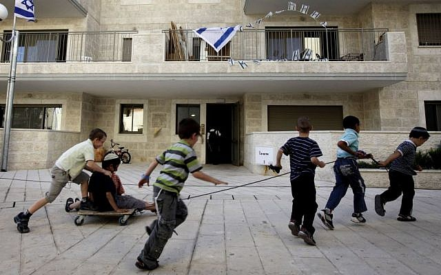 Jewish boys play before a dedication ceremony for the Jewish neighborhood of Ma'ale HaZeitim, inside the Arab-dominated area of Ras el Amud in East Jerusalem, May 25, 2011. (photo credit: Miriam Alster/Flash90)