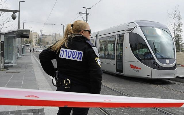 An Israeli police officer stands guard at the scene of a stabbing attack on the light rail in Pisgat Zeev in 2012. (photo credit: Uri Lenz/FLASH90)