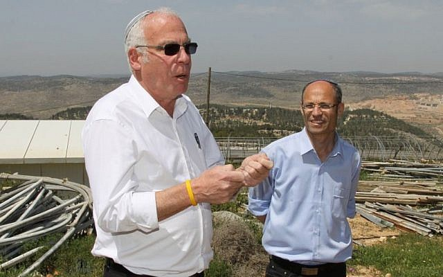 David Perl, right, with housing and construction minister Uri Ariel during a visit to Gush Etzion,  April 1, 2014 photo credit: Gershon Elinson/Flash90)