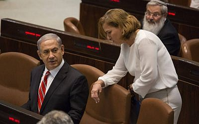 Benjamin Netanyahu speaks with Tzipi Livni during a plenum session in the Knesset in June 2014. (photo credit: Flash90)