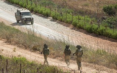 Israeli army jeeps patrol along the Northern Israeli border with Lebanon on July 14, 2014. (Ayal Margolin/Flash90)