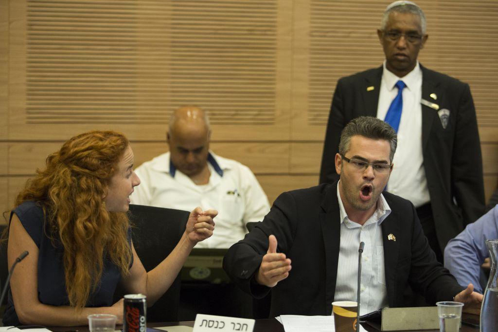 Labor MK Stav Shaffir (L) argues with Yesh Atid parliament member Boaz Toporovski during a Finance committee meeting regarding 0-VAT law, at the Knesset on September 3, 2014. (photo credit: Noam Revkin Fenton/Flash90)
