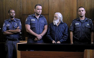 Goel Ratzon, second from right, attends his verdict in the district court room in Tel Aviv on Monday, September 8, 2014. (Photo credit: Dror Einav/Pool/Flash90)