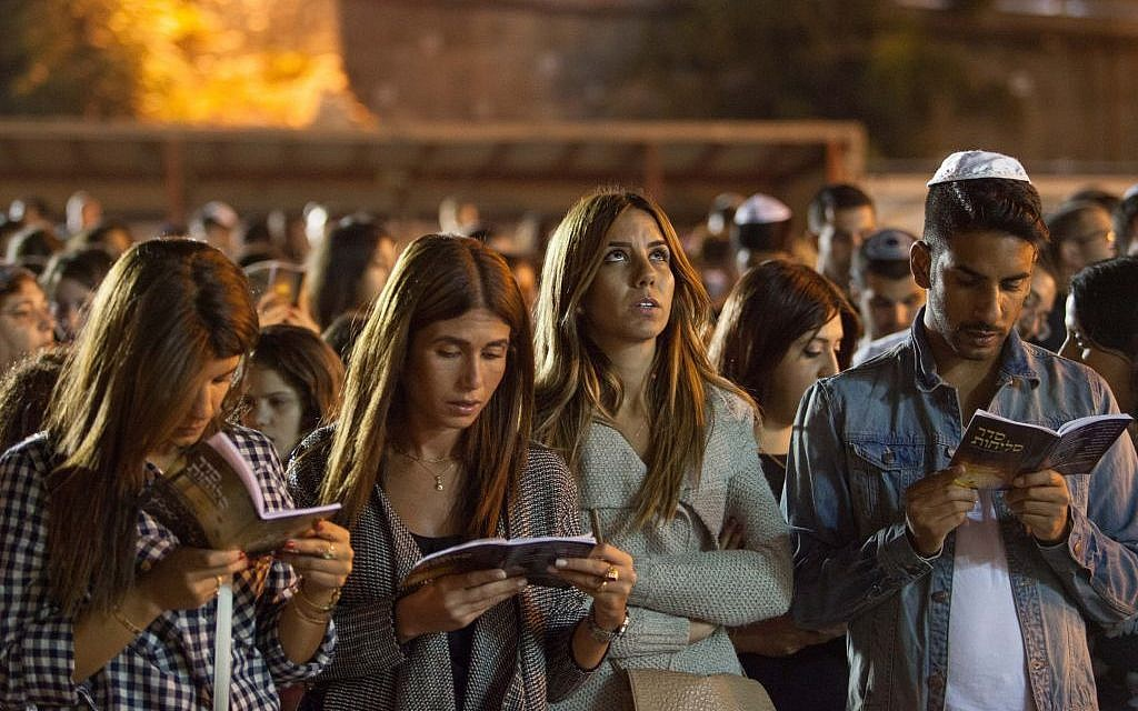 Jewish men and women praying together for forgiveness (Selichot), at the Western Wall in the Old City of Jerusalem, September 24, 2014. (Photo credit: Noam Revkin Fenton/FLASH90)