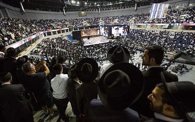 Thousands gather in memory of the spiritual leader of Israel's ultra-Orthodox Shas party Rabbi Ovadia Yosef at the arena in Jerusalem, on September 28 ,2014 (photo: Noam Revkin Fenton/Flash90 )