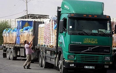 Trucks loaded with aid enter the Gaza Strip from Israel through the Kerem Shalom crossing on October 12, 2014 (photo credit: Abed Rahim Khatib/Flash90)