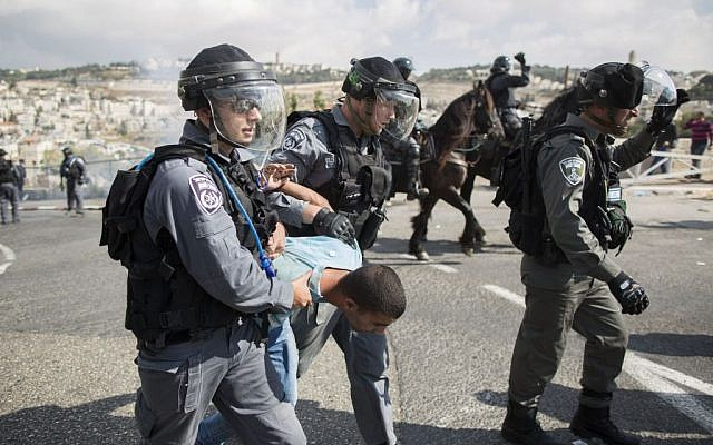 A Palestinian man is detained by Israeli border policemen during a protest after authorities restricted access to Temple Mount, October 15, 2014 (photo credit: Yonatan Sindel/Flash90)