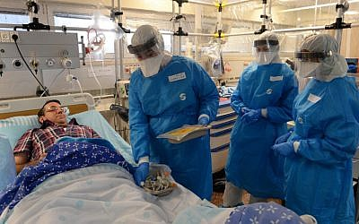 Israeli officials take part in a Ebola identification training exercise at Sheba Medical Center in Ramat Gan on October 17, 2014. (photo credit: Kobi Gideon/GPO)