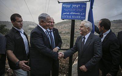 Prime Minister Benjamin Netanyahu (left); President Reuven Rivlin; Agriculture Minister, and son of Yitzhak Shamir, Yair Shamir; and Jerusalem Mayor Nir Barkat (right) inaugurate the Yitzhak Shamir Road, Route 9, on October 19, 2014. (photo credit: Hadas Parush/Flash90)