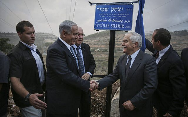 Prime Minister Benjamin Netanyahu (left); President Reuven Rivlin; Agriculture Minister, and son of Yitzhak Shamir, Yair Shamir; and Jerusalem Mayor Nir Barkat (right) inaugurate the Yitzhak Shamir Road, Route 9, on October 19, 2014. (photo credit: Hadas Parush/Flash90)